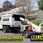Reliable Tree Service truck driving to a job in Bedford County.